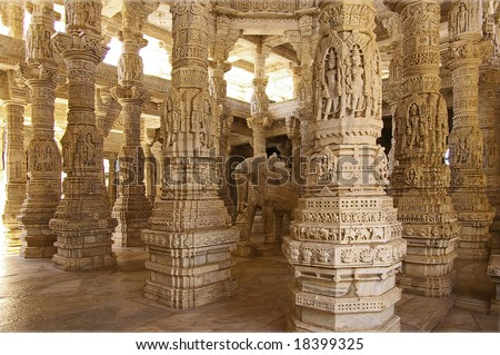 Columned hall of a Jain Temple in Ranakpur,India. Each marble column does not repeat another - stock photo