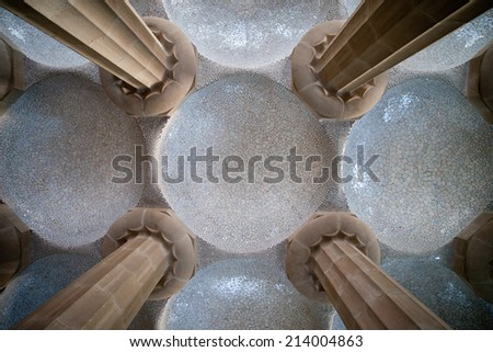 Columns and domes, tiled ceiling of Hypostyle Room in Park Guell, Barcelona, Catalonia, Spain. - stock photo