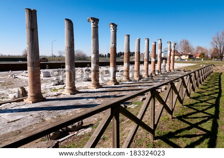 Columns and fence on Archeological area of Aquileia in Italy - stock photo