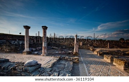 Columns and mosaic in the ancient roman city of Stobi - stock photo