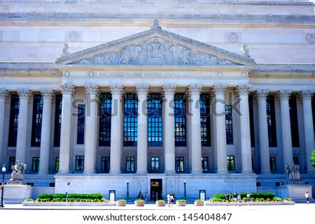 Columns and reliefs decorate the north face of the National Archives building in Washington DC. - stock photo