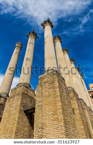 Columns in archaeological ruins of the Roman temple of Cordoba (Spain), which was built in the first century after Christ. - stock photo