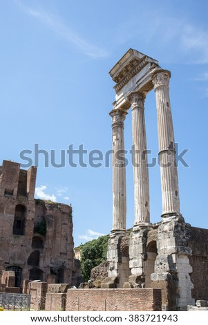 Columns in the Roman Forum in Rome Italy, one of the most famous landmarks in the world set against a blue sky.  Concepts could include history, government, architecture, tourism, and many more. - stock photo