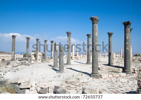 Columns in Umm Qais (Gadara). Jordan. - stock photo