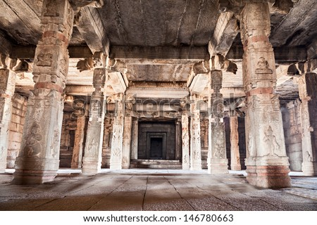 Columns inside the very old hindu temple - stock photo
