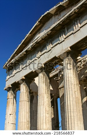 Columns of an ancient greek temple in summer day - stock photo