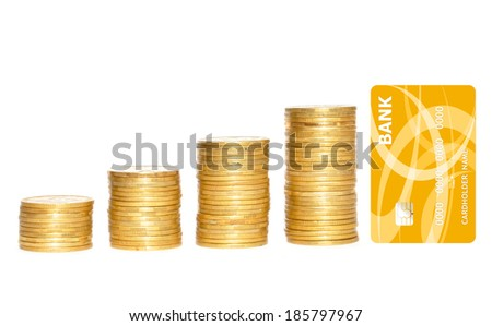 columns of gold coins and golden credit card isolated on white background - stock photo
