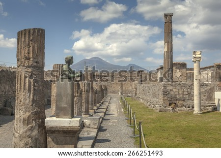 Columns of temple of Apollo with statue of godess Diane in Pompeii, Italy - stock photo