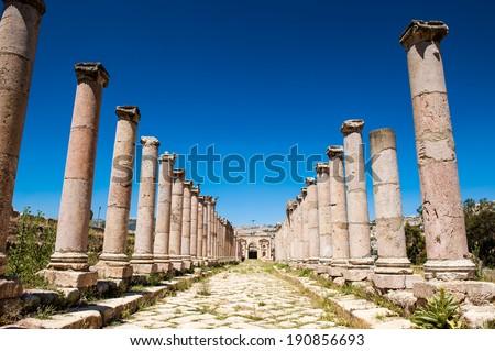 Columns of the cardo maximus, Ancient Roman city of Gerasa of Antiquity , modern Jerash, Jordan - stock photo