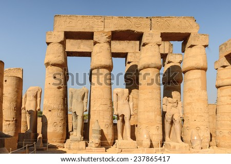 Columns of the Luxor Temple, a large Ancient Egyptian temple, East Bank of the Nile, Egypt. UNESCO World Heritage - stock photo