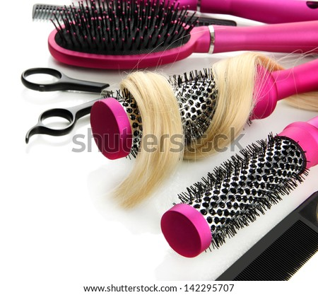 Comb brushes, hair and cutting shears, isolated on white - stock photo