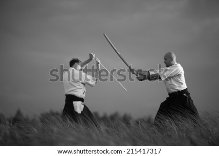 Combat between samurai, martial arts concept - stock photo
