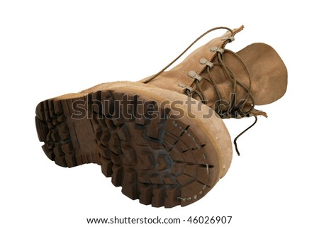 Combat Boot laying on ground, isolated - stock photo
