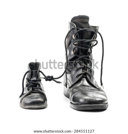 Combat boots for adult and kid in concept of father and son in family isolated on white with clipping path - stock photo