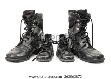 Combat boots for adult and kid in family concept isolated on white background - stock photo