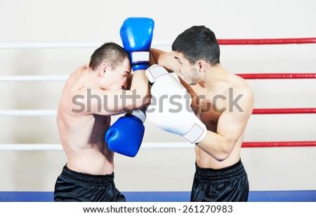 combat sport muai thai sportsman fighting at training boxing ring - stock photo