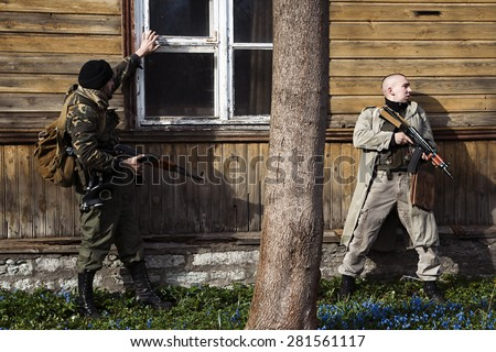 Combats waiting for the order to attack - stock photo