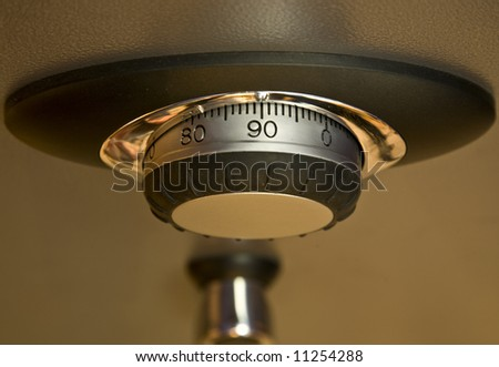 Combination lock and handle on a safe. - stock photo