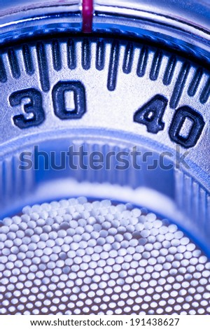 Combination lock on safe, toned blue - stock photo