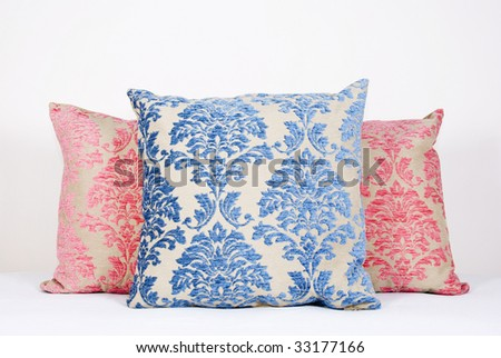 Combination of different colored and patterned pillows - stock photo