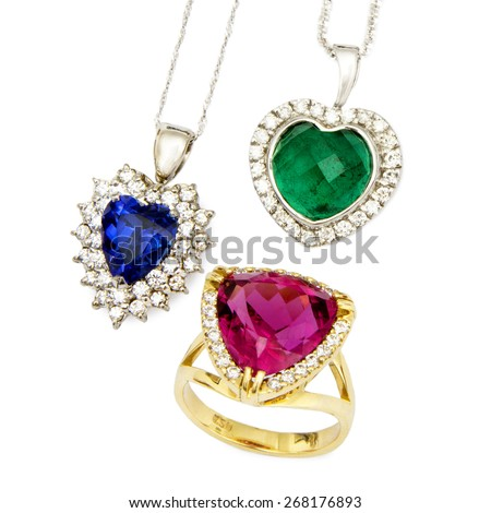 Combination of Three Jewellery Pieces: Heart Shaped Sapphire and Diamond Pendent, Heart Shaped Emerald and Diamond Pendent, and a Ruby and Diamond Ring, Isolated on White Background - stock photo