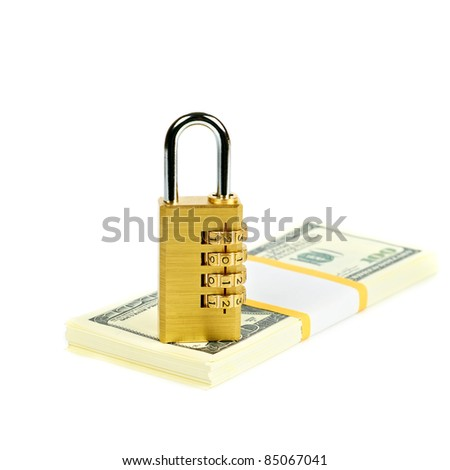 combination padlock on a stack of dollars - stock photo