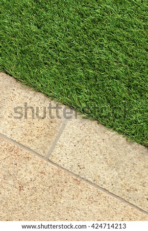 Combinations of concrete floor and green artificial grass landscaping design ideas - stock photo