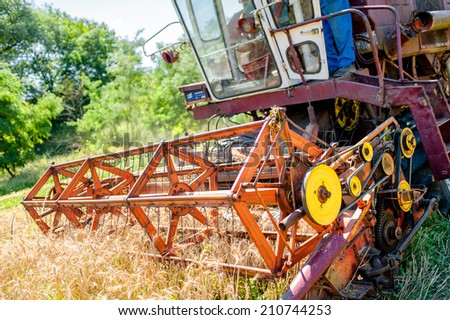 combine corn and wheat harvester. Agriculture industry on rural crops - stock photo