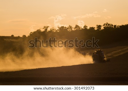 Combine harvested grain at sunset. Simple monochrome image. Widespread Dust - stock photo