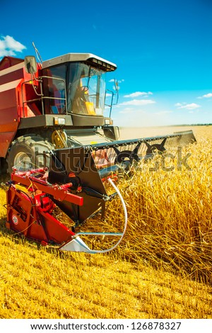 combine harvester close up - stock photo