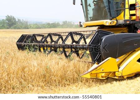 combine harvester in motion - stock photo