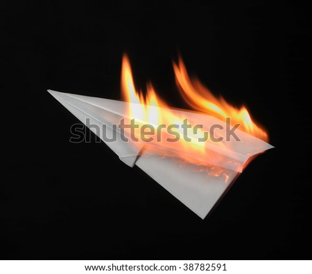 Combustion paper airplane - stock photo