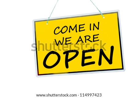 come in we are open sign hanging isolated on a white background - stock photo