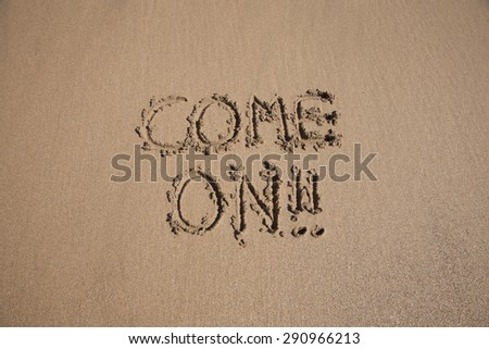 come on word written on brown sand ground low tide beach ocean seashore in Spain Europe - stock photo
