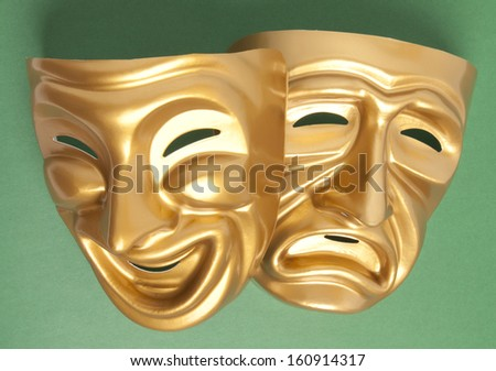Comedy and Tragedy theatrical mask on a green background  - stock photo