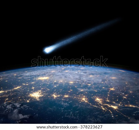Comet and Earth. Elements of this image furnished by NASA. - stock photo