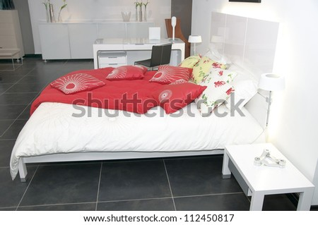 comfortable and cozy white bedroom - stock photo