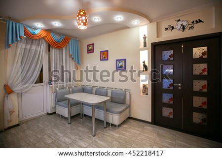 Comfortable apartment in the orange and blue tones. Kitchen with dining room. interior, flat, design, architectural design, style, color, orange, blue, suspended ceilings, floor tiles, painting - stock photo