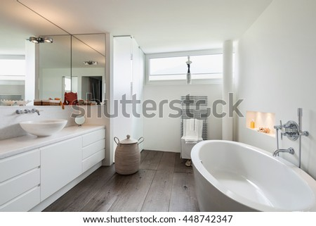 comfortable bathroom in modern design, wooden floor - stock photo