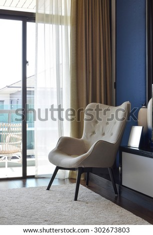 comfortable chair on carpet in modern bedroom interior - stock photo