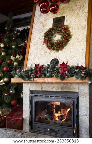 Comfortable christmas decorated fireplace - stock photo