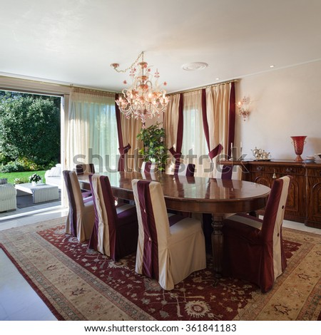 comfortable dining room of an house, classic design furniture - stock photo