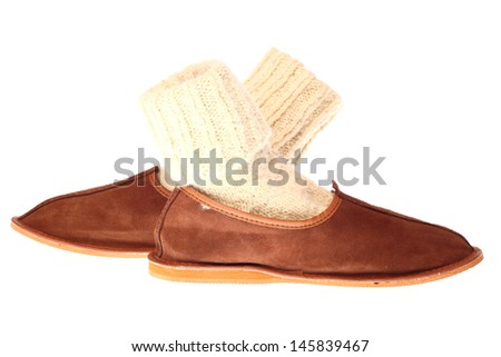 comfortable domestic fluffy slippers isolated - stock photo
