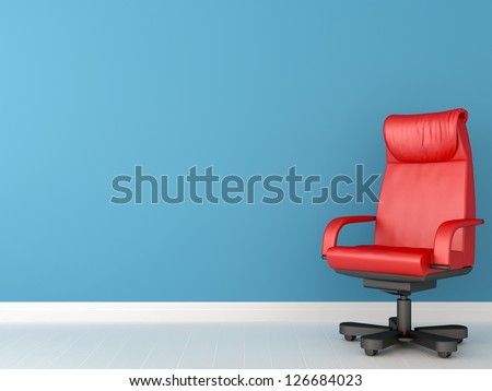 Comfortable office chair in red creates a contrasting composition against a blue wall, which can be used for background - stock photo