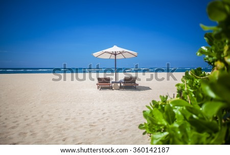 Comfortable sitting on the tropical beach - stock photo