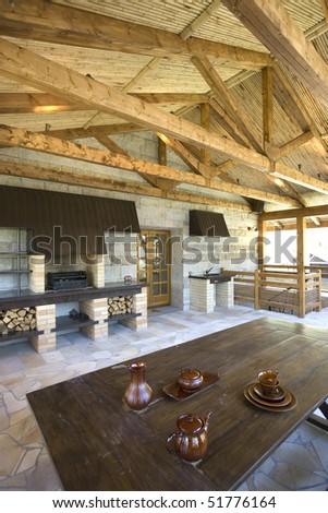 Comfortable veranda  in rustic house - stock photo