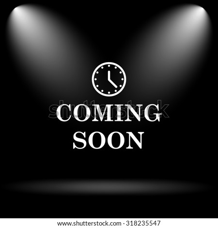 Coming soon icon. Internet button on black background. - stock photo