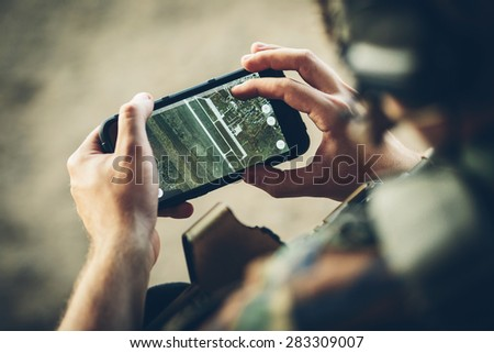 commander of the Rangers paves the route on an electronic tablet - stock photo
