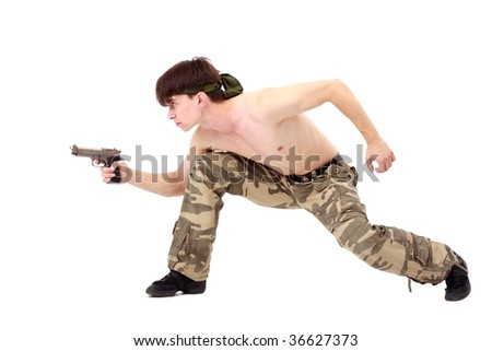 Commando. Man with gun on a white background. - stock photo