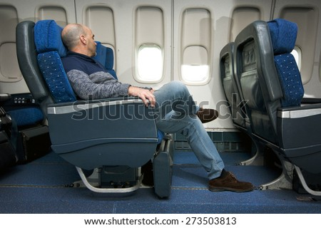 commercial airline passenger in comfortable seat  inside the plane - stock photo
